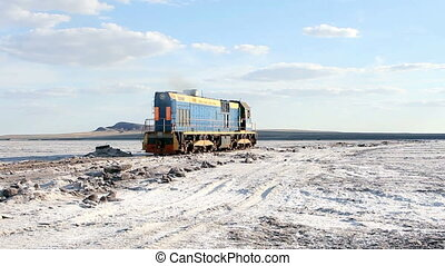 train on the salt lake Baskunchak - Russian Federation,...