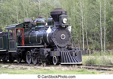 Train on Track - Antique train on track, with smoke out of...