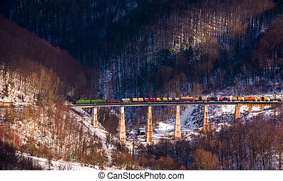 train over viaduct in winter mountains. lovely...