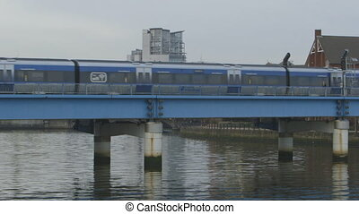 Train Passes By On Bridge - Steady, exterior, medium wide...