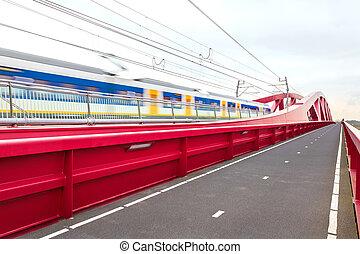 Train passing a bridge in Overijssel, The Netherlands