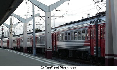 Train passing by the railway station. - Passenger train...