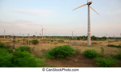 Train passing by wind farm