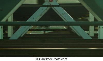 Train passing on bridge, close up