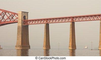 Train passing on the Forth bridge (or Forth rail bridge) near Edinburgh, Scotland.