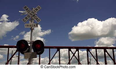 Train Passing Railroad Crossing - A train trips the signal...
