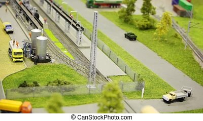 train pushes tank wagon on rail in modern toy city to fuel...