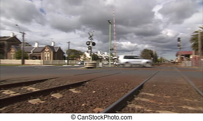 Train rail on a road - A low angle pan to left shot from a...