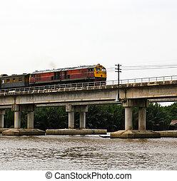 Train ran on bridge over the river