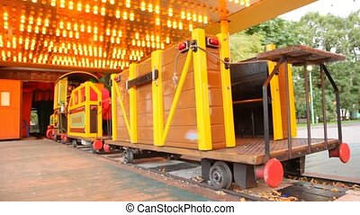 Train ride in amusement park with dynamic illumination