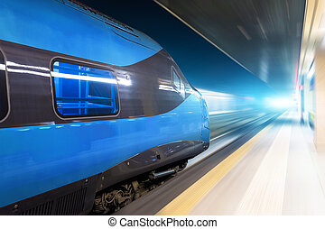 Train rides at riding at high speed at night in a glowing tunnel.