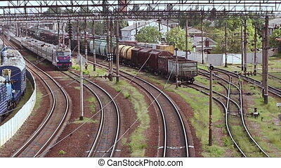 Train running along the rails on a sunny day. Traffic -...