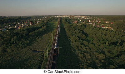 Train running in the village, aerial view