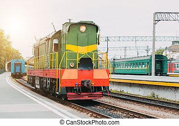 Train, shunting locomotive on the passenger platform.