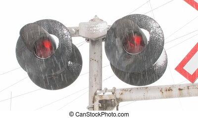 Train signals in snow. 2 shots.