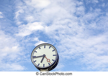 train station clock under blue sky