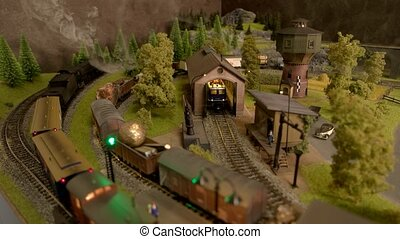 Train station of a miniature train. Model trains with steam ...