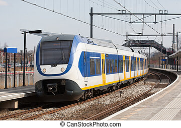 Train stopping in trainstation in The Netherlands