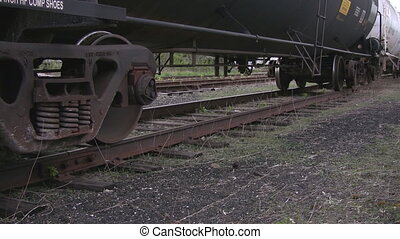 Train tanker pan highlighting wheels on tracks