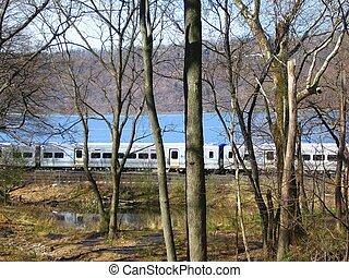 train through trees - the railroad along the Hudson River
