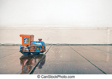 train toy wooden floor - old tin toy train on a wooden floor...