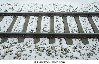 train tracks buried in snow