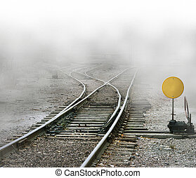 Photo Illustration of train tracks splitting with a blank sign ready for your unique message to be added.