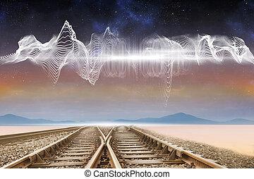 Train tracks under energy wave in desert