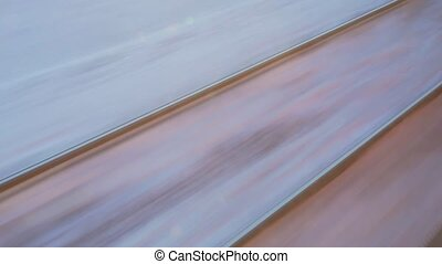 train travel in winter. view from the window. snow covered railroad tracks