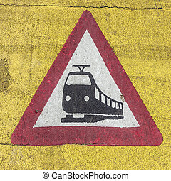 train warning sign at a railroad crossing for pedestrians