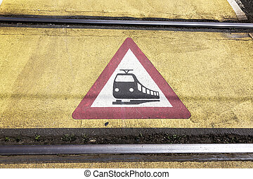 train warning sign at a railroad crossing