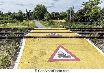 train warning sign at a railroad crossing