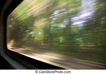 train window view - green trees - a blurred window view from...