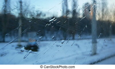 Train window winter rain
