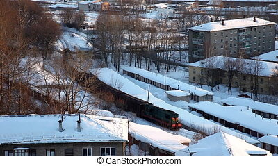 Train with cargo in winter city