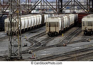 Train Yard - Rail road cars parked in a train yard on a...