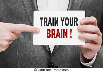 Train Your Brain. Card in businessman hand
