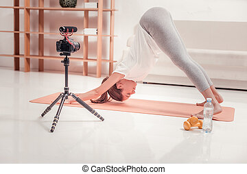 Trained lady making an exercise on the floor