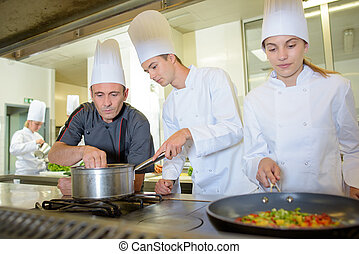 Trainee chefs, cooking