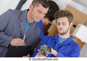 Trainee mechanic identifying part
