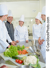 Trainees in kitchen with chef