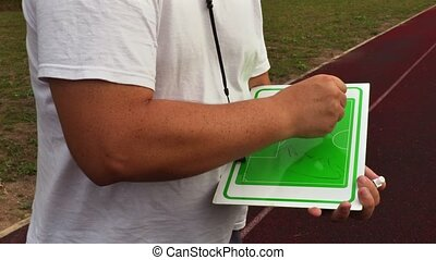 Trainer drawing on board the attack plan