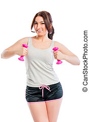 trainer exercising with dumbbells in studio