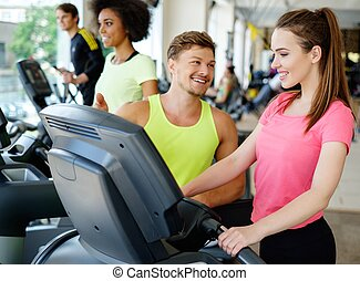 Trainer explaining how to use treadmill