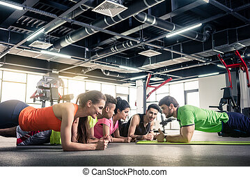 Trainer giving training at gym