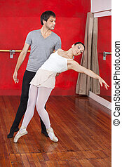 Trainer Performing With Ballerina In Studio