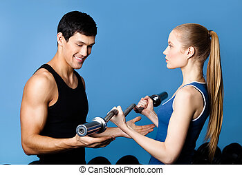 Trainer shows woman the correct exercise performing