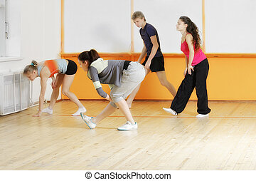 Trainer teaching group to make exercise