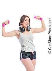 Trainer with a dumbbell and headphones on a white background