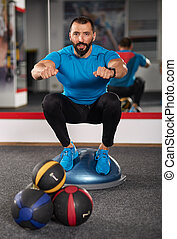 Trainer working with balance ball